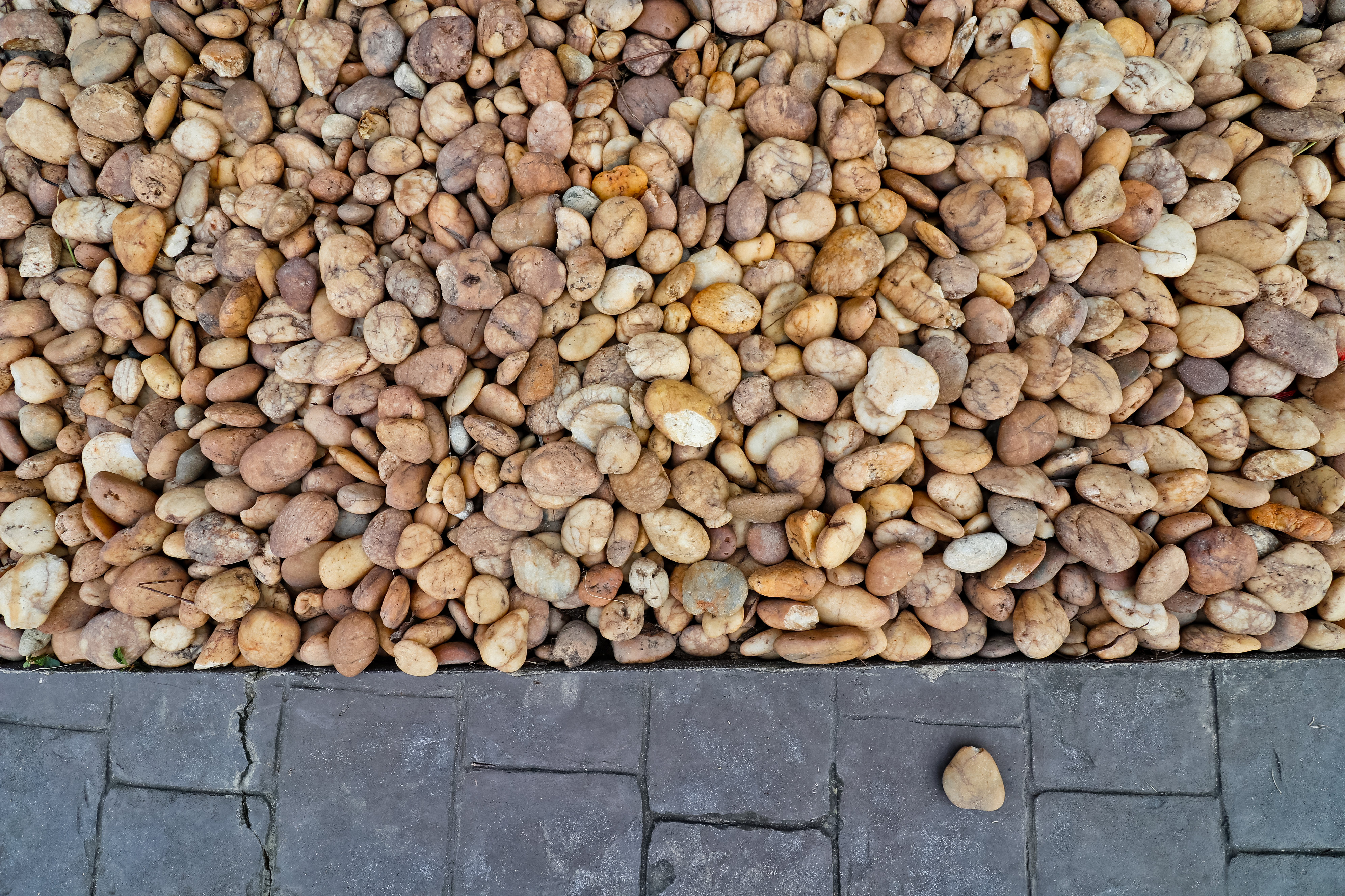Abstract background: Decorative floor pattern of small gravel and seamless stones, Gravel texture
